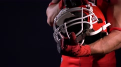 American football sportsman player in darkness Stock Footage