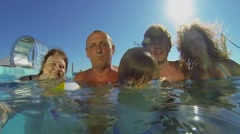 Six people family deep into water of pool on hotel roof Stock Footage