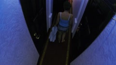 Woman walks among doors in corridor and room of hotel. Stock Footage
