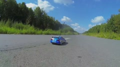 Wireless toy racing car rides by road at sunny day. Stock Footage