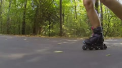 Wireless toy car rides among people which ride on roller-skates Stock Footage