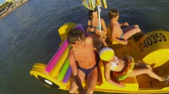 Four people family sail on catamaran in sea not far from beach Stock Footage