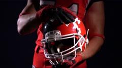 American football player holding helmet Stock Footage
