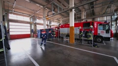Two fireman change clothes in garage near truck in Moscow, Russia Stock Footage
