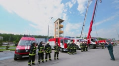 Firemen formation near special transport at fire station Stock Footage