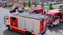 People and special transport during training on fire station at spring Stock Footage