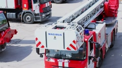 Fire-engine ride by fire-post parking place at sunny day Stock Footage