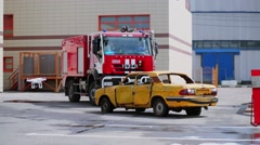 Drone flies near broken car and fire truck on parking during training Stock Footage