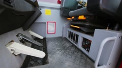 Empty cabin of fire crane with pedals and driver chair Stock Footage