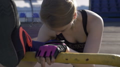 Young athlete woman warming up in the stadium Stock Footage
