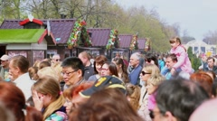Crowd of people at market place in park during fair Stock Footage