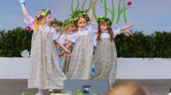 Eight girls in country dresses dance on stage, Moscow Stock Footage