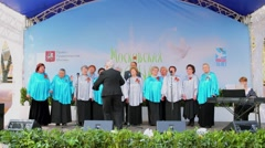 Performance of choir with conductor and musician on stage Stock Footage