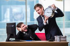 Two twins businessmen arguing with each other over deadline Stock Photos