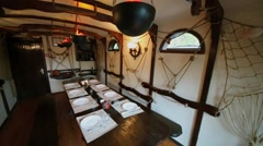 Interior of restaurant room stylized as old ship cabin Stock Footage