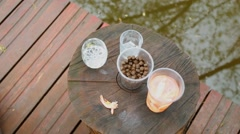 Shrimps and oiled bran as snacks for drinks near water of pond Stock Footage