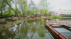 Public garden with fish farm and piers for fishing on pond Stock Footage