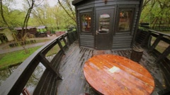 Exterior of restaurant stylized as boat on pond in park Stock Footage
