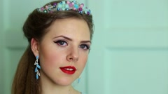 Beautiful young woman smiles with jewelery on head closeup in studio Stock Footage