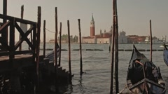 Parked gondolas on Piazza San Marco and The Doge's Palace embankment with the Stock Footage