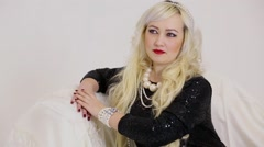 Blonde poses with necklace and diadem on blond curly hairs Stock Footage