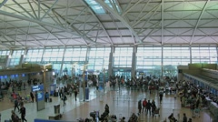Large hall of airport with crowd of people. Timelapse Stock Footage