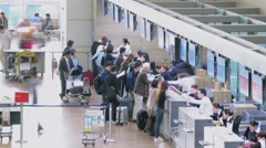 Airport check-in with many people. Timelapse Stock Footage