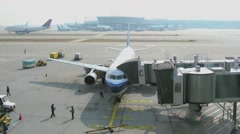 Several planes on runway and terminals of airport at sunny day Stock Footage