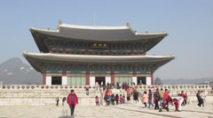 Lot of tourists walk near building of Geyongbokgun Palace Stock Footage