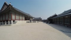 Many tourists walk by complex of Geyongbokgun Palace Stock Footage