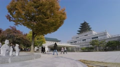 Crowds of people walk near main building of Geyongbokgun Palace Stock Footage