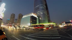 Pedestrian cross road with transport traffic near Lotte Tower Stock Footage