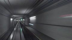 Underground tunnel with illumination behind train during ride. Stock Footage