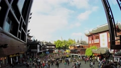 People walk by Yuyuan Garden and 9 Turns bridge on pond Stock Footage