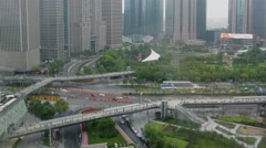 City traffic near Lujiazui Park among skyscrapers at autumn day Stock Footage