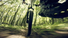 Mountain biking downhill in a forest descending fast on bicycle. View from the Stock Footage