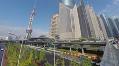 City traffic not far from Oriental Pearl TV Tower at autumn sunny day Stock Footage