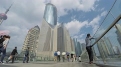 Pedestrians walk by bridge among skyscrapers at autumn day. Stock Footage