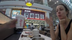 Woman eat in fast-food restaurant Kung Fu. Timelapse Stock Footage