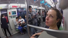 Woman and other people ride in metro train by tunnel. Timelapse Stock Footage