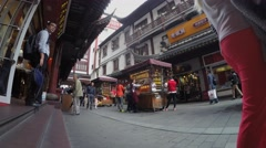 Many people walk by Yuyuan Gardens marketplace. Timelapse Stock Footage