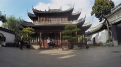 Many people walk near ancient style building in Yuyuan Gardens. Stock Footage