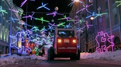 Snow remover works on street with colourful illumination at winter Stock Footage