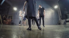 Six people dance team performs in studio. Timelapse Stock Footage
