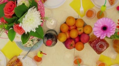 Holiday table with meals and guest hands. Timelapse Stock Footage