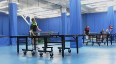 Several people play table tennis in gym. Timelapse. Moscow. Stock Footage