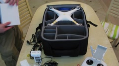 Man assembles DJI Phantom quadrocopter on table. Timelapse Stock Footage