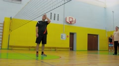Competition of two volleyball teams in gym. Timelapse Stock Footage