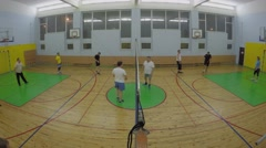 Gym with two teams play volleyball. Timelapse Stock Footage