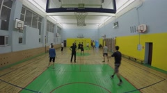 Volleyball game of amateurs in gym. Timelapse Stock Footage